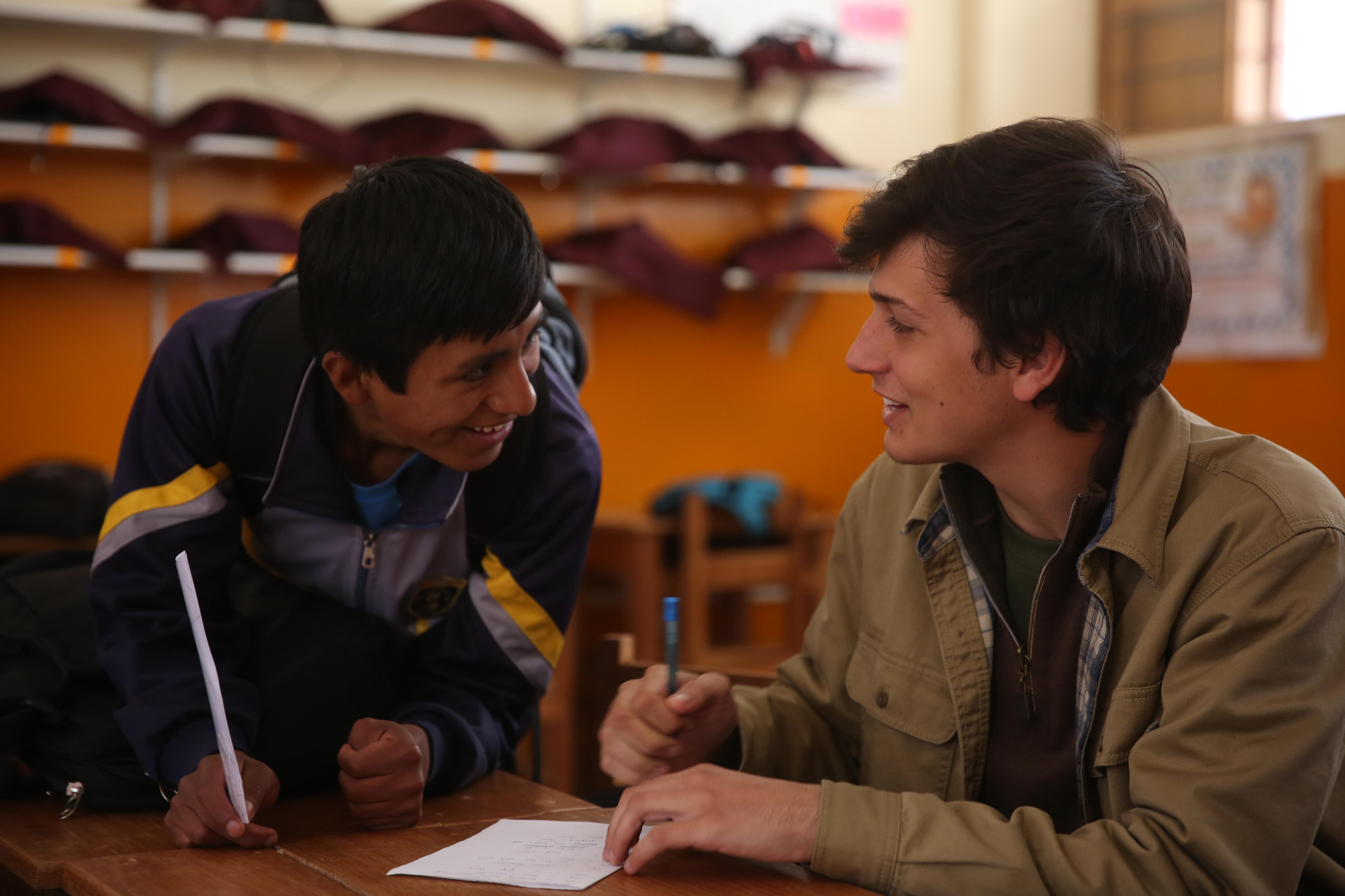 Projects Abroad volunteer has a conversation with one of his students during his teaching work experience in Peru